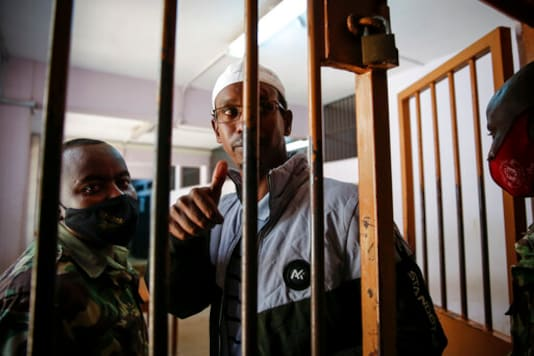 Liban Abdullah Omar, who was found innocent of supporting the gunmen involved in the Westgate Mall attack in Sept. 2013, gestures after the verdict was delivered in the trial at Milimani court in the capital Nairobi, Kenya Wednesday, Oct. 7, 2020. A Kenyan court on Wednesday found two men guilty of supporting the 2013 attack by gunmen with the Somalia-based extremist group al-Shabab on Nairobi's upscale Westgate Mall that left 67 people dead, while Chief Magistrate Francis Andayi acquitted a third suspect. (AP Photo/Brian Inganga)