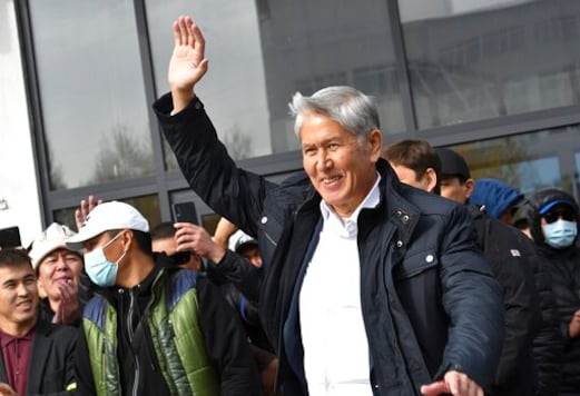 Former President Almazbek Atambayev waves to his supporters in Bishkek, Kyrgyzstan, Friday, Oct. 9, 2020. Sooronbai Jeenbekov, the embattled president of Kyrgyzstan, has moved to end the political turmoil that followed a disputed parliamentary election, ordering a state of emergency in the capital. Jeenbekov has faced calls to resign by protesters who stormed government buildings after Sundays parliamentary vote was reportedly swept by pro-government parties. Protesters freed former President Almazbek Atambayev, who was jailed on charges seen by his supporters as a political vendetta. (AP Photo/Vladimir Voronin)