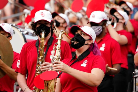 FILE - In this Saturday, Sept. 12, 2020 file photo, a reduced size Oklahoma band performs in the stands in the second half of an NCAA college football game against Missouri State in Norman, Okla.  Marching bands, part of the game since its beginning more than a century ago, are idled or toned down across the country. They wont be able to perform in front of the usual crowds at football games, dramatically changing the experience.    (AP Photo/Sue Ogrocki, File)