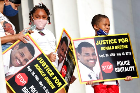 FILE - In this Aug. 28, 2020 file photo, family members of Ronald Greene listen to speakers as demonstrators gather for the March on Washington, in Washington, on the 57th anniversary of the Rev. Martin Luther King Jr.'s
