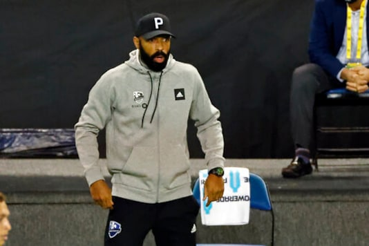 Montreal Impact coach Thierry Henry reacts during the first half of the team's MLS soccer match against Nashville SC, Tuesday, Oct. 27, 2020, in Harrison, N.J. (AP Photo/Adam Hunger)
