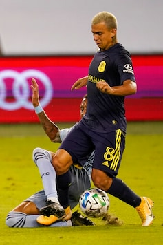 Sporting Kansas City defender Amadou Dia, back, sweeps the ball from Nashville SC midfielder Randall Leal (8) during the first half of an MLS soccer match in Kansas City, Kan., Sunday, Oct. 11, 2020. (AP Photo/Orlin Wagner)