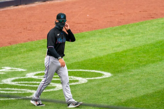 Miami Marlins manager Don Mattingly walks onto the field for a pitching change during the fifth inning of a baseball game against the New York Yankees at Yankee Stadium, Saturday, Sept. 26, 2020, in New York. (AP Photo/Corey Sipkin)