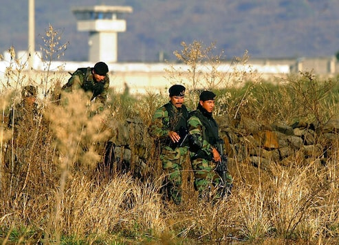 FILE - In this Jan. 28, 2005 file photo, Mexican Army soldiers inspect the surrounding the top-security Puente Grande prison, on the outskirts Guadalajara City, Mexico. The Mexican government announced Monday, Sept. 28, 2020, that it will close the Puente Grande federal prison made famous by the 2001 escape of convicted drug lord Joaquin