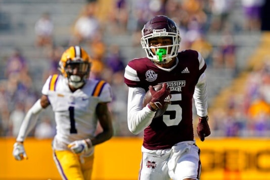 Mississippi State wide receiver Osirus Mitchell (5) carries on a touchdown reception as he is pursued by LSU cornerback Eli Ricks (1) in the first half an NCAA college football game in Baton Rouge, La., Saturday, Sept. 26, 2020. (AP Photo/Gerald Herbert)