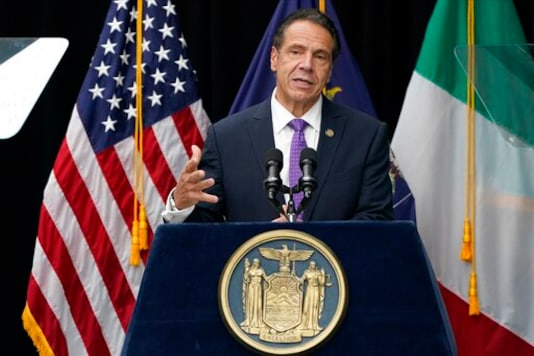 New York Gov. Andrew Cuomo speaks at a ceremony to unveil the statue of the patron saint of immigrants, Mother Frances Cabrini, in Battery Park Monday, Oct. 12, 2020, in New York. (AP Photo/Frank Franklin II)