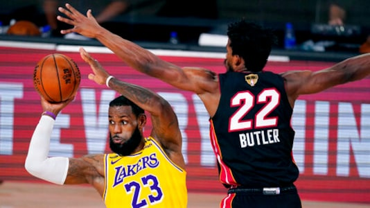 Los Angeles Lakers' LeBron James (23) looks to pass while pressured by Miami Heat's Jimmy Butler (22) during the second half of Game 1 of basketball's NBA Finals Wednesday, Sept. 30, 2020, in Lake Buena Vista, Fla. (AP Photo/Mark J. Terrill)