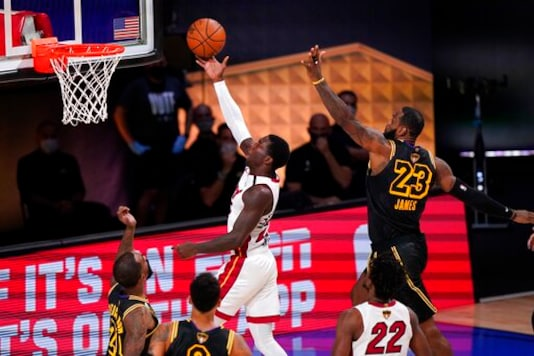 Miami Heat's Kendrick Nunn, left, goes up for a shot after getting past Los Angeles Lakers' LeBron James (23) during the second half of Game 2 of basketball's NBA Finals, Friday, Oct. 2, 2020, in Lake Buena Vista, Fla. (AP Photo/Mark J. Terrill)