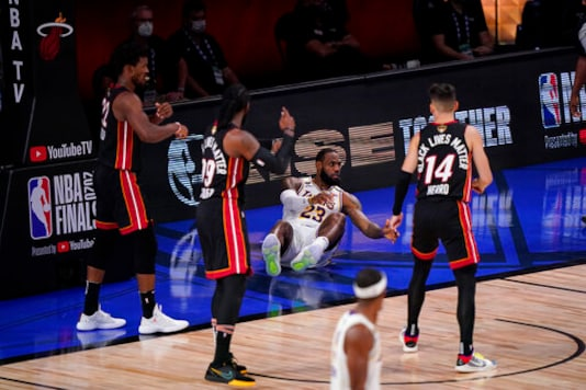 Los Angeles Lakers' LeBron James (23) reacts after a fall during the second half in Game 3 of basketball's NBA Finals against the Miami Heat, Sunday, Oct. 4, 2020, in Lake Buena Vista, Fla. (AP Photo/Mark J. Terrill)