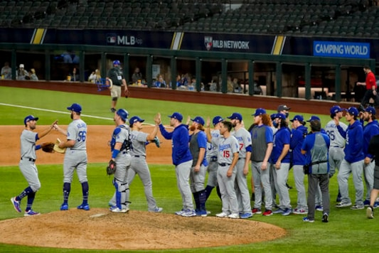 Los Angeles Dodgers celebrate their win against the Atlanta Braves in Game 3 of a baseball National League Championship Series against the Atlanta Braves Wednesday, Oct. 14, 2020, in Arlington, Texas. (AP Photo/Tony Gutierrez)