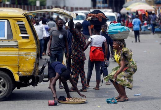 Passengers disembarked from a commercial bus in Lagos Saturday, Oct. 24, 2020. Nigeria's president says 51 civilians have been killed in unrest following days of peaceful protests over police abuses, and he blames