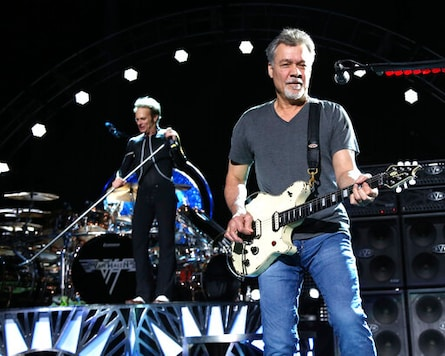 FILE - David Lee Roth, left, and Eddie Van Halen of Van Halen perform on Aug. 13, 2015, in Wantagh, N.Y. Van Halen, who had battled cancer, died Tuesday, Oct. 6, 2020. He was 65. (Photo by Greg Allen/Invision/AP, File)