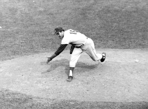 FILE - In this Aug. 17, 1963, file photo, Los Angeles Dodgers pitcher Ron Perranoski throws against the New York Mets at the Polo Grounds in New York. Perranoski, one of the Dodgers' greatest lefthanded relievers of all-time, passed away at the age of 84 on Friday, Oct. 2, 2020, at his home in Vero Beach, Fla. (AP Photo/John Rooney, File)