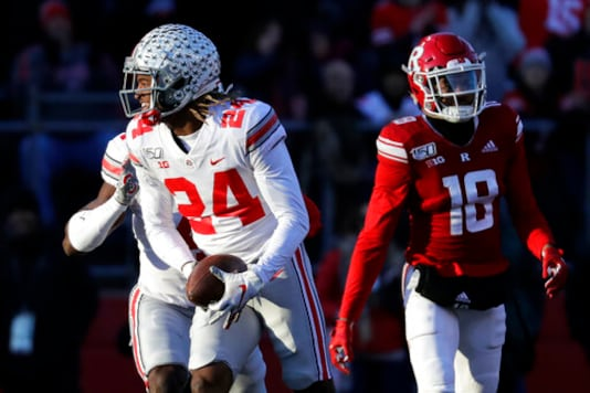 FILE- In this Nov, 16, 2019, file photo, Ohio State cornerback Shaun Wade (24) reacts after making an interception during the first half of an NCAA college football game against Rutgers in Piscataway, N.J. Two of Ohio States biggest stars, Guard Wyatt Davis and cornerback Shaun Wade, have decided to stay and play football for the Buckeyes this year. (AP Photo/Adam Hunger, File)