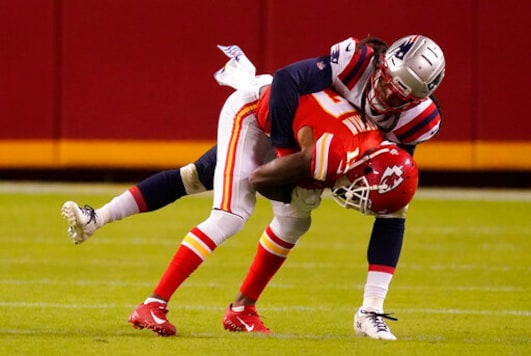 Kansas City Chiefs wide receiver Mecole Hardman is tackled by New England Patriots cornerback Stephon Gilmore, rear, during the second half of an NFL football game, Monday, Oct. 5, 2020, in Kansas City. (AP Photo/Charlie Riedel)