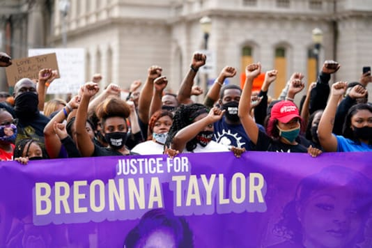FILE - In this Sept. 25, 2020, file photo, Black Lives Matter protesters march in Louisville. Hours of material in the grand jury proceedings for Taylors fatal shooting by police have been made public on Friday, Oct. 2. (AP Photo/Darron Cummings, File)