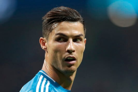 FILE - In this Sept. 18, 2019, file photo, Juventus' Cristiano Ronaldo looks back during the Champions League Group D soccer match in Madrid, Spain. Ronaldo's legal fight with a woman who accuses the international soccer star of raping her in his suite at a Las Vegas resort more than 10 years ago is heading toward a court hearing before a federal judge in Las Vegas. (AP Photo/Bernat Armangue, File)