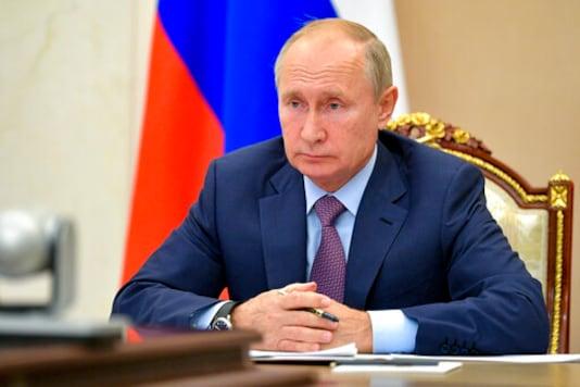 Russian President Vladimir Putin chairs a Security Council meeting via video conference in Moscow, Russia, Wednesday, Oct. 14, 2020. (Alexei Druzhinin, Sputnik, Kremlin Pool Photo via AP)