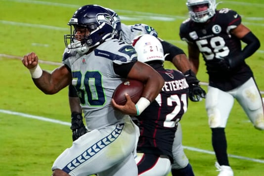 Seattle Seahawks running back Carlos Hyde (30) runs in for a touchdown against the Arizona Cardinals during the first half of an NFL football game, Sunday, Oct. 25, 2020, in Glendale, Ariz. (AP Photo/Rick Scuteri)