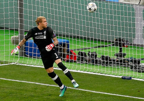 FILE - In this Saturday, May 26, 2018 file photo Liverpool goalkeeper Loris Karius looks at the ball after a fumble allowed Real Madrid's Gareth Bale to score his side's 3rd goal during the Champions League Final soccer match between Real Madrid and Liverpool at the Olimpiyskiy Stadium in Kiev, Ukraine. A return to the Bundesliga relegation fight was never part of the plan for Loris Karius. More than two years after high-profile mistakes for Liverpool while concussed in a Champions League final, the German goalkeeper has returned to his homeland for the latest step in trying to to rebuild his once-promising career. (AP Photo/Darko Vojinovic, File)