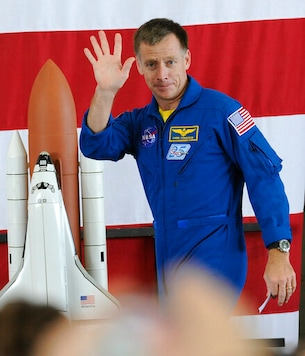 FILE - In this Friday, July 22, 2011 file photo, space shuttle commander Chris Ferguson waves to the crowd at the welcome home ceremony for the astronauts of the final shuttle mission in Houston. On Wednesday, Oct. 7, 2020, Ferguson removed himself from the first Boeing crew, citing his daughters wedding in 2021. He has been replaced on the Starliner crew by Butch Wilmore. (AP Photo/Pat Sullivan)