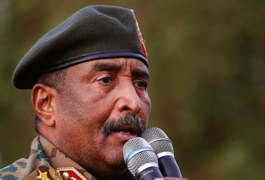 FILE - Sudanese Gen. Abdel-Fattah Burhan speaks during a military-backed rally in Omdurman district, west of Khartoum, Sudan, Saturday, June 29, 2019. Sudans leader said Monday, Oct. 26, 2020 that the decision to normalize ties with Israel was an incentive for President Donald Trumps administration to end Sudans international pariah status. Gen. Abdel-Fattah Burhan, head of the ruling sovereign council, told state television that without the deal Sudan would have had to wait until deep into next year to be removed from the U.S.'s list of state sponsors of terrorism. (AP Photo/Hussein Malla, file)