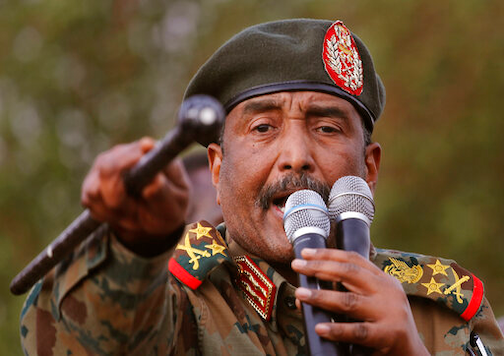 FILE - In this June 29, 2019 file photo, Sudanese Gen. Abdel-Fattah Burhan, head of the military council, speaks during a military-backed rally, in Omdurman district, west of Khartoum, Sudan. Officials in Sudan confirmed that a senior U.S.-Israeli delegation flew to Sudan on a private jet Wednesday, Oct. 21, 2020, and met with Burhan and others to wrap up a deal that would make Sudan the third Arab country to normalize ties with Israel this year. (AP Photo/Hussein Malla, File)