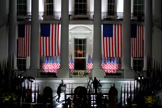 The White House stands ready for President Donald Trump to watch as Supreme Court Justice Clarence Thomas will administer the Constitutional Oath to Amy Coney Barrett on the South Lawn of the White House in Washington later tonight, Monday, Oct. 26, 2020, after Barrett is confirmed as expected by the Senate tonight. (AP Photo/Carolyn Kaster)