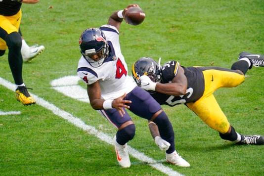Houston Texans quarterback Deshaun Watson (4) tries to get past Pittsburgh Steelers inside linebacker Devin Bush (55) on a scramble during the first half of an NFL football game, Sunday, Sept. 27, 2020, in Pittsburgh. (AP Photo/Gene J. Puskar)