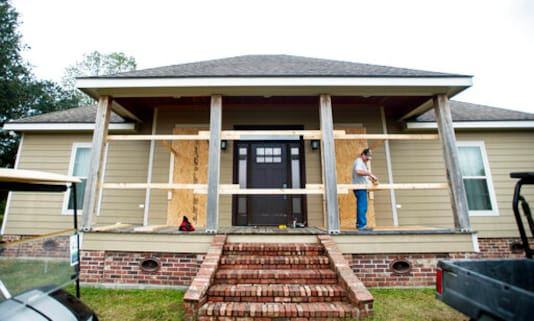 Curt Duhon boards up windows on his son's house to prepare for Hurricane Delta Thursday, Oct. 8, 2020, north of Abbeville, La. (Leslie Westbrook/The Advocate via AP)