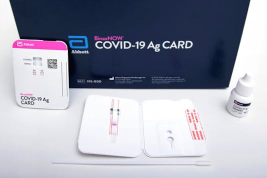 FILE - This image provided by Abbott Laboratories in August 2020 shows the company's BinaxNOW rapid COVID-19 nasal swab test. After months of struggling to ramp up coronavirus testing, the U.S. is now capable of testing some 3 million people daily thanks to a growing supply of rapid tests. But the testing boom comes with a new challenge: keeping track of the results. (Abbott Laboratories via AP)