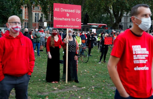 Workers from the event industry protest at Parliament Square in London, Tuesday, Sept. 29, 2020, demanding help for their industry after the shutdown due to the coronavirus outbreak. (AP Photo/Frank Augstein)