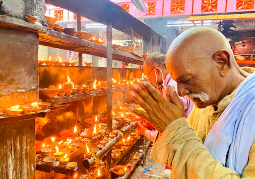 An elderly Hindu offers prayers at the Vindhyavasini temple in Mirzapur in the northern Indian state of Uttar Pradesh, Saturday, Oct. 17, 2020. Health officials have warned about the potential for the coronavirus to spread during the upcoming religious festival season, which is marked by huge gatherings in temples and shopping districts. (AP Photo/Rajesh Kumar Singh)
