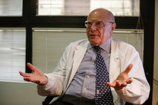 Virologist Massimo Galli, director of the Sacco hospital in Milan, answers questions during an interview with the Associated Press, at the Sacco hospital, in Milan, Italy, Thursday, Oct. 15, 2020. (AP Photo/Luca Bruno)