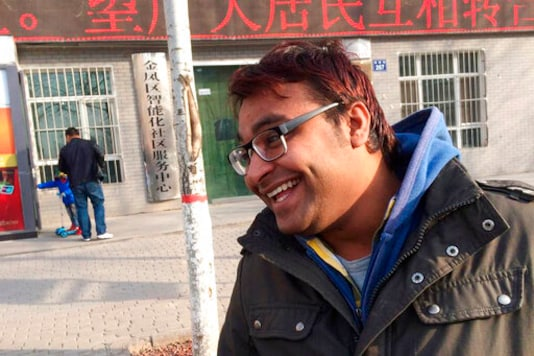 In this Dec. 23, 2014, photo Joginder Chaudhary smiles after completing a clinical class at Ningxia Medical University in Yinchuan, China. After the virus killed the 27-year-old Chaudhary in late July 2020, his mother wept inconsolably. With her son gone, Premlata Chaudhary said, how could she go on living? Three weeks later, on Aug. 18, the virus took her life, too  yet another number in an unrelenting march toward a woeful milestone. (Courtesy of Aravind Kumar via AP)