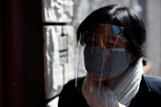 Social worker Guadalupe Ramos of the Romero Rubio Health Center wears two face masks and a face shield as she makes house calls to follow up with local residents who have recently tested positive for COVID-19, in Mexico City, Wednesday, Oct. 7, 2020. (AP Photo/Rebecca Blackwell)