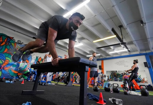 *Jorge Garcia works out, Monday, Aug. 31, 2020, at Legacy Fit in the Wynwood Art District of Miami. As the vast majority of in-person fitness clubs switched to virtual classes when the pandemic hit, Legacy Fit took the opposite approach. (AP Photo/Wilfredo Lee)