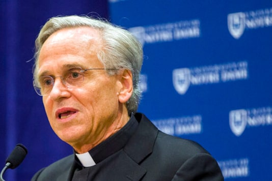 FILE - In this Oct. 11, 2019, file photo, University of Notre Dame President Rev. John I. Jenkins speaks during a news conference in South Bend, Ind. University of Notre Dame President Rev. John Jenkins has ended his period of quarantine after he tested positive for the coronavirus less than a week following his attendance at a White House event without wearing a mask. Jenkins