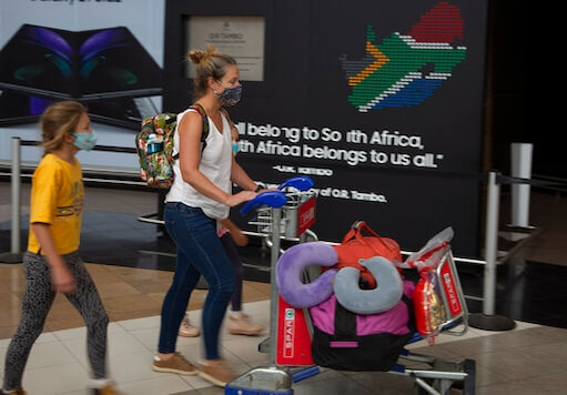Passengers from Kenya enter the arrivals hall at the O.R. Tambo Airport in Johannesburg, Thursday Oct. 1, 2020. South Africa has reopened to international flights, ending a six-month ban on international travel that was part of its restrictions to combat the spread of COVID-19. (AP Photo/Denis Farrell)