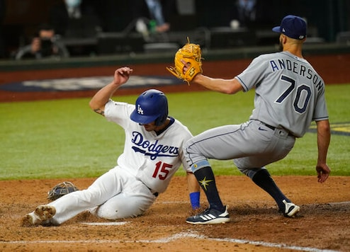 Los Angeles Dodgers' Austin Barnes scores past Tampa Bay Rays relief pitcher Nick Anderson on a wild pitch during the sixth inning in Game 6 of the baseball World Series Tuesday, Oct. 27, 2020, in Arlington, Texas. (AP Photo/Eric Gay)