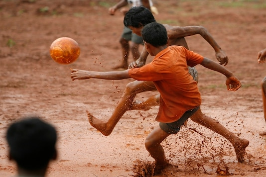 Boys play football in shorts at a village. (Image for representation/REUTERS)
