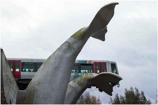 An unsightly sculpture of a whale's tail fin saved a train from spiralling out into harm's way in Rotterdam, Netherlands | Image credit: AP