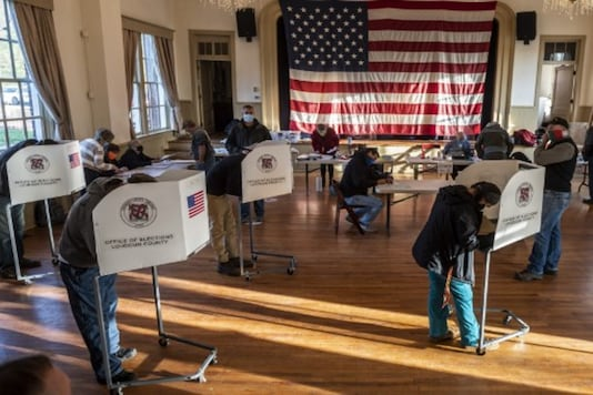 Voters cast their ballots at a school in Hillsboro, Virginia, on Tuesday morning. (AFP)
