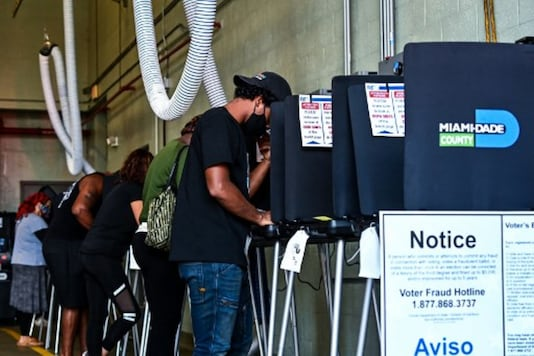Voters cast their ballots at the Indian Creek Fire Station 4 in Miami, Florida, on Tuesday. (AFP)