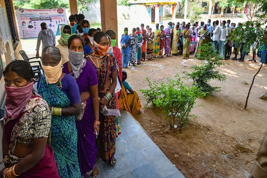 Voters stand in a long queue to cast their votes for Dubbaka by-election in Hyderabad on Tuesday. (PTI)