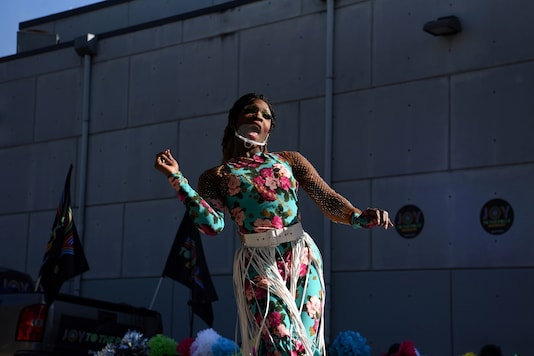 FILE PHOTO: A drag queen with Joy to the Polls performs as voters cast ballots at Buddy's Houston, the world's first presidential polling location at an LGBTQ+ bar, on Election Day in Houston, Texas, U.S., November 3, 2020. REUTERS/Callaghan O'Hare/File Photo