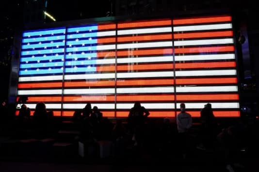 People watch election results in Times Square in New York early on November 4. (AFP)