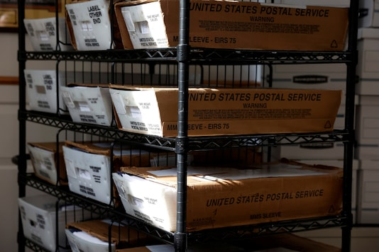 Boxes with mail-in ballots wait to be counted at the Northampton County Courthouse on Election Day in Easton, Pennsylvania, U.S., November 3, 2020. REUTERS/Rachel Wisniewski