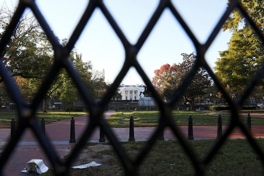 A view of the White House through a fence after early results of the 2020 U.S. presidential election were announced, in Washington, US, November 4, 2020. (Image: REUTERS)