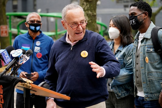 New York Senator Chuck Schumer speaks at a news conference outside an early voting site in New York, Tuesday, October 27, 2020.